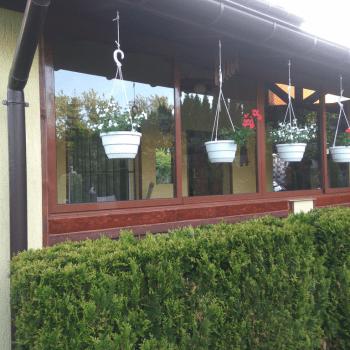 розсувні алюмінієві вікна двері на терасу альтанку веранду безрамні дешеві львів